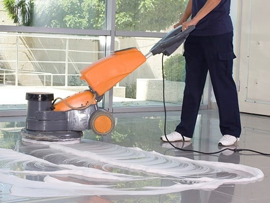 Cleaning the floor with machine